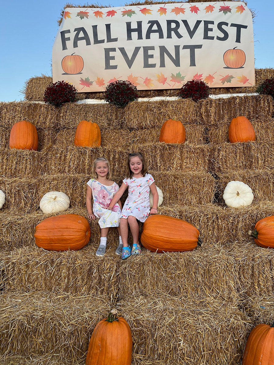 Vechione family at Fall Harvest event with haybales & pumpkins