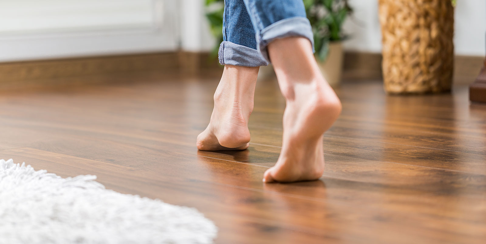 Happy customer walking barefoot on new hardwood floors.